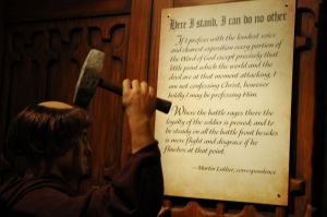 Martin Luther nailing his 95 Thesis to the Church Door