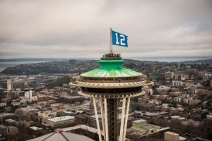 The 12th Man Flag Flying over the Space Needle