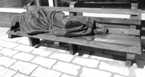 "A statue entitled ""Homeless Jesus."""