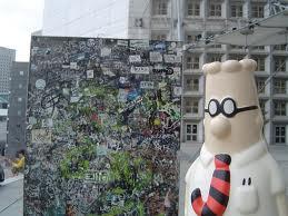 Dilbert looking on
