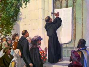 A depiction of Martin Luther nailing his 95 Theses to the Wittenberg Church Door on October 31, 1517