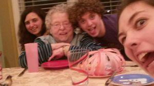 Taking a funny picture with Grandma around the table