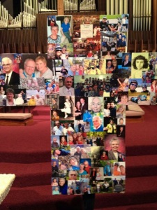 "A cross covered in pictures of the ""living saints"" who are part of a particular faith community's body and congregation."