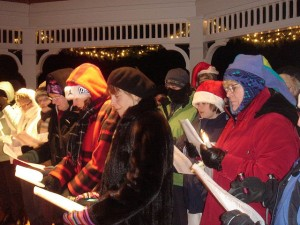 What a group of carolers looks like, when they are outside (especially in places like Minnesota). Thankfully, were singing carols around a fireside nice and warm this morning.