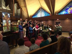 """The choirs singing """"Ride on King Jesus"""""""