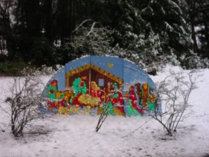 Growing up, we had snow fall a few times around Christmas. Here's one example of snow around a nativity, with the 3 kings off to the right.