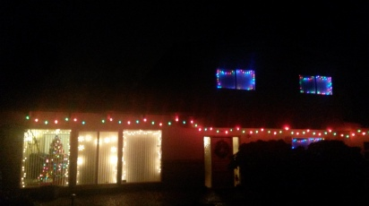 Our lit up house on a dark and rainy night.